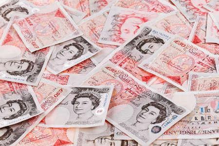 sterlina: £ 50 sterline banconote primo piano sfondo vista lavorativo