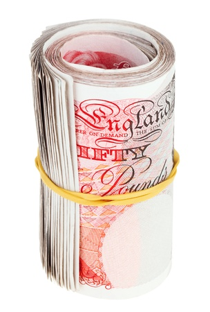 esterlino: Pound sterling rolled up bank notes, isolated on white