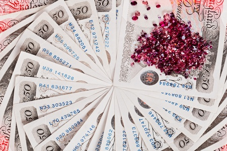 quid: 50 pound sterling bank notes with diamonds closeup view business background