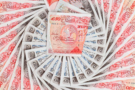 50 pound sterling bank notes closeup view business background photo