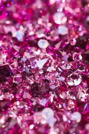 Many small ruby diamond stones, luxury background shallow depth of field photo