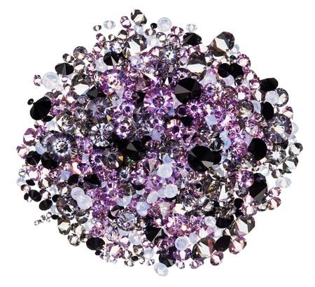 Many small purple diamond (jewel) stones heap isolated on white photo