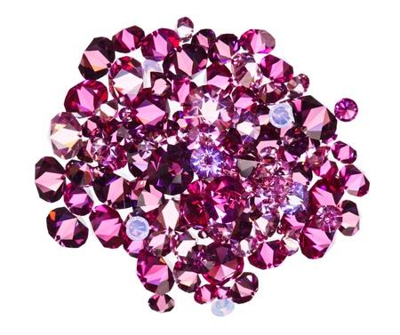 Many small ruby diamond (jewel) stones heap isolated on white photo