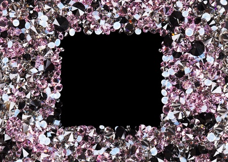 Square frame made from many small purple diamonds, with copyspace on black photo