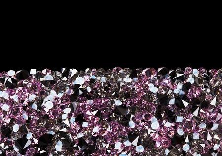 Purple diamond jewel stones luxury background with copy space on black photo