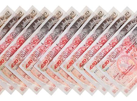 libra esterlina: Muchos 50 libras esterlinas billetes de banco de negocios de fondo, aislado en blanco Foto de archivo