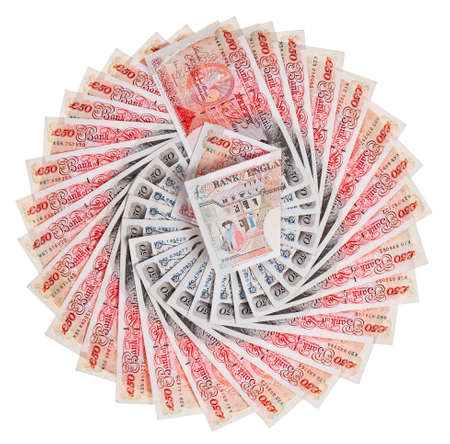 quid: Many 50 pound sterling bank notes fanned out, isolated on white Stock Photo