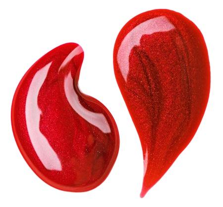 赤いマニキュア (エナメル) が値下がりしましたサンプルでは、白で隔離されます。 写真素材