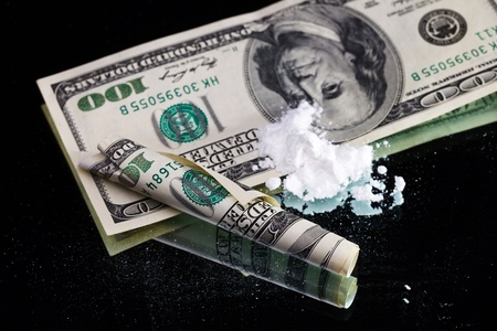 Cocaine drugs heap still life on a mirror with rolled 100 dollar bank note, close up view Stock Photo - 11884693