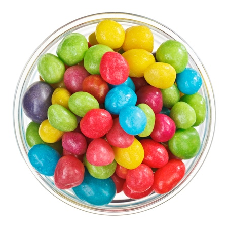 stone bowl: Multicolor bonbon sweets (ball candies) in glass bowl, isolated on white
