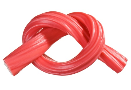 licorice: Red gummy candy  licorice  rope, isolated on white closeup view