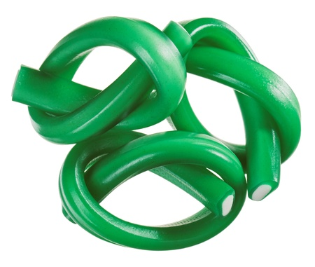 Green gummy candy  licorice  rope set, isolated on white closeup view photo