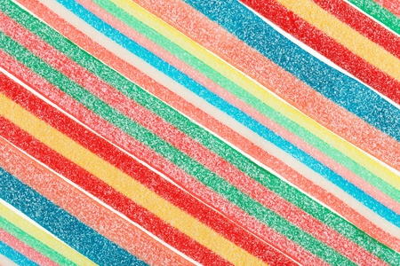 candy stripe: Multicolor gummy candy (licorice) sweets closeup food background Stock Photo