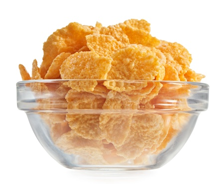 cornflakes: Corn flakes heap in a glass bowl, isolated on white