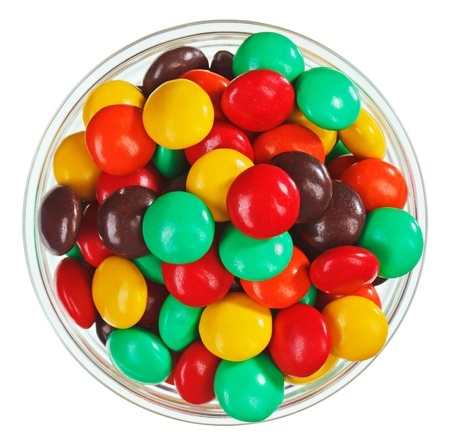 Multicolor bonbon sweets (ball candies) in glass bowl, isolated on white photo