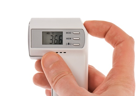 Modern infra-red digital thermometer with hand isolated on white Stock Photo - 12838508