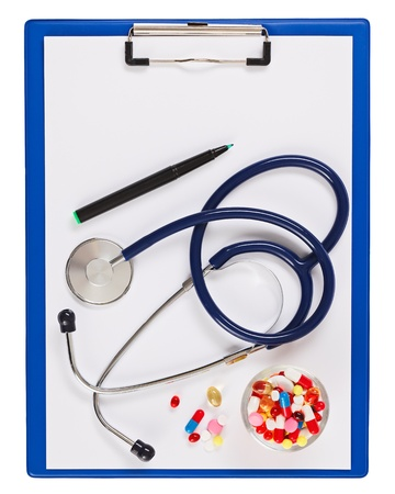 Blue medical clipboard with stethoscope and pills isolated on white photo