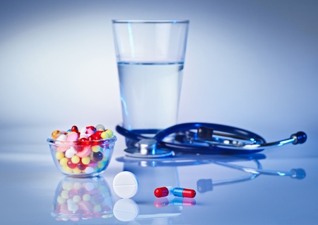 Pills and tablets macro still life on white blue, medical therapeutic concept Stock Photo - 12838798