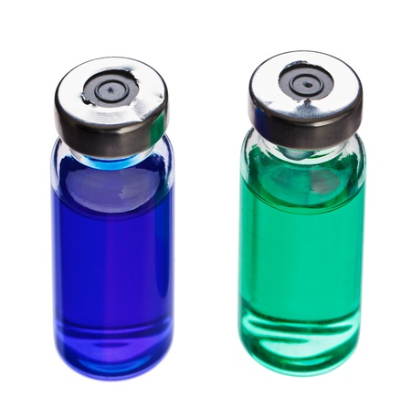 vials: Blue and green medical ampoules isolated on a white