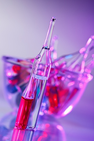 pharmacology: Medical ampoules still life in vivid violet colors
