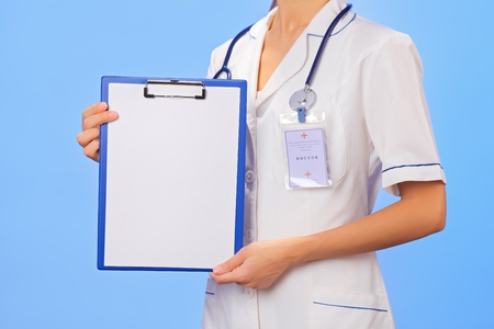 Doctor with copyspaced clipboard waist-high portrait on blue Stock Photo - 13009651