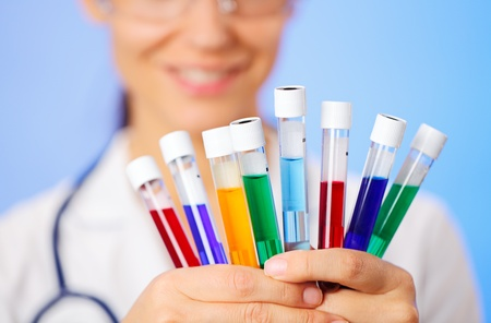 Medical multicolor test tubes with fluid sample in doctor hands closeup Stock Photo - 13009657