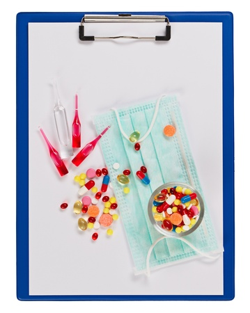 Medical concept with clipboard, pills and ampoules isolated on white Stock Photo - 13424040