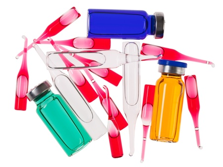 Multicolor medical ampoules isolated on a white photo