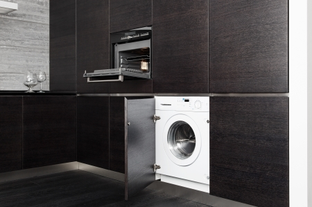 Build-in washing machine and cooker on modern black kitchen Stock Photo - 14883189