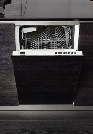 Open dish washer machine on black hardwood kitchen photo