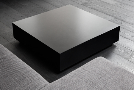 Black square coffee-table, modern interior detail photo