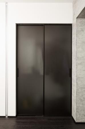 closet door: Sliding-door wardrobe in modern hall interior