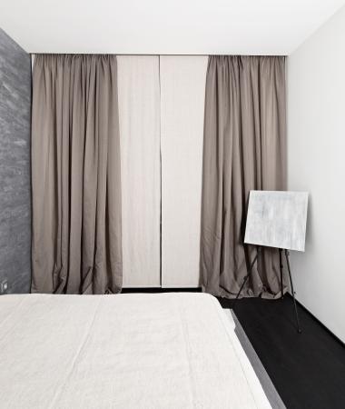 Modern minimalism style bedroom interior in monochrome tones photo