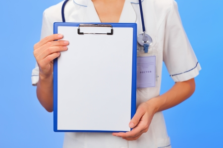 therapeutic: Doctor with copyspaced clipboard waist-high portrait on blue