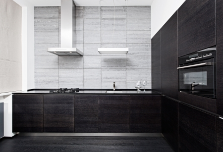 clean kitchen: Part of modern minimalism style kitchen interior in monochrome tones