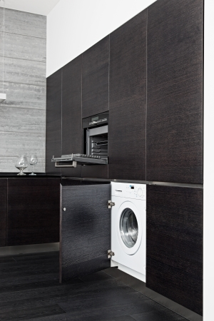 Build-in washing machine and cooker on modern black kitchen Stock Photo - 14959138