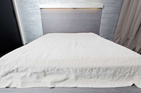 Bed with bedspread in modern bedroom top wide angle view photo