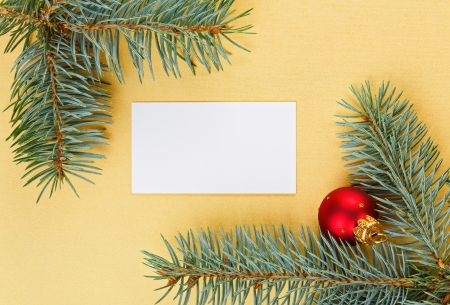 Empty card on golden Christmas background with spruce branches Stock Photo - 15293188