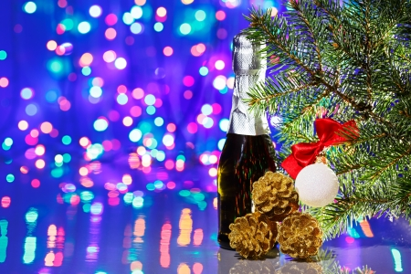 Christmas tree decorations with spruce and champagne on bokeh background Stock Photo - 15293187
