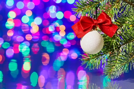 Christmas tree decoration ball with spruce branch on bokeh background Stock Photo - 15292363
