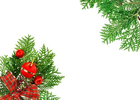 x mas: Red balls, ribbon and thuja twig Christmas composition, isolated on white Stock Photo