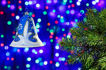 New Year decorations bell on multicolor circles bokeh background photo