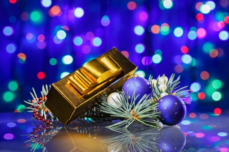New Year decorations composition with golden fancy box on bokeh background Stock Photo - 15586880