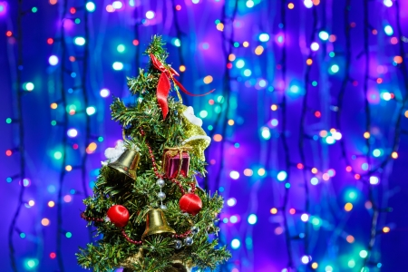 Decorated Christmas tree on multicolor bokeh background Stock Photo - 15586899