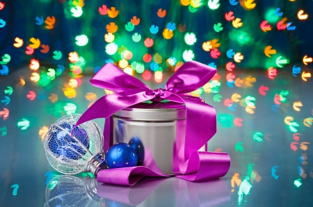 Christmas decorations composition with fancy box on snowflake shaped bokeh background photo