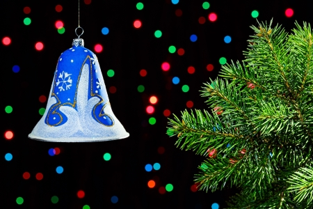 New Year decorations bell on da�k multicolor circles bokeh background photo