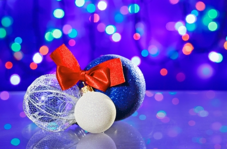 New Year decoration ball toys with red ribbon bow on circles bokeh background Stock Photo - 15766508