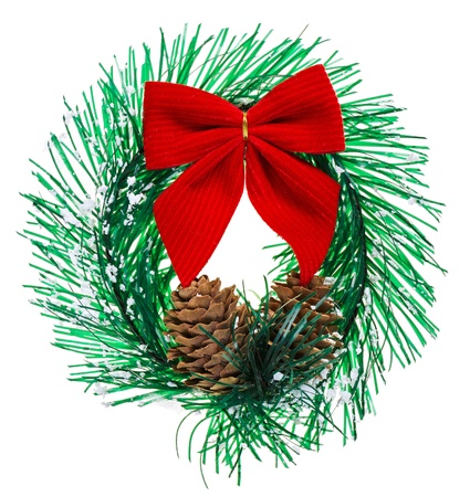Christmas wreath with cones and red bow, isolated on white photo