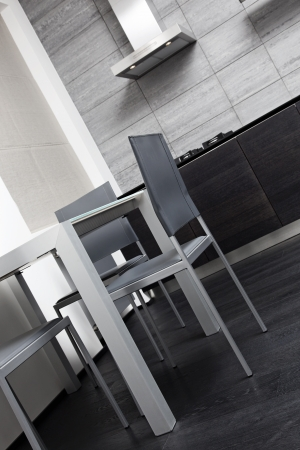 Fragment of modern minimalism style kitchen with dining table photo