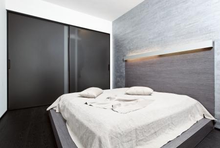 laconic: Modern minimalism style bedroom interior in beige tones Stock Photo